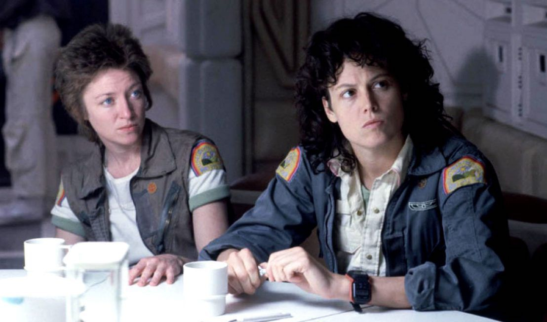 Veronica Cartwrightas Lambert and Sigourney WeaverasEllen Ripley sit side by side in Alien.