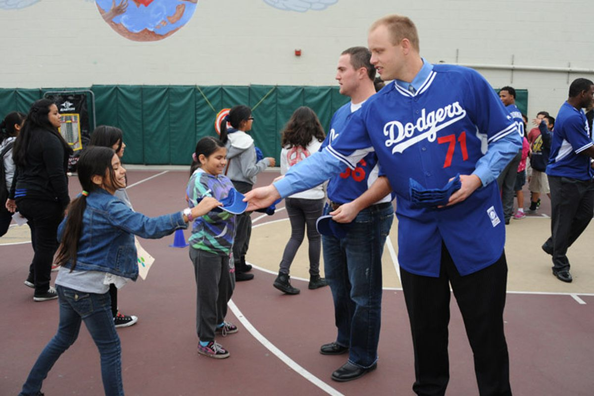 """Seth Rosin, number 71, gives out Dodgers caps at """"A Place Called Home"""" Tuesday"""