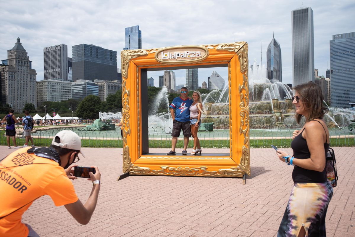 People pose for a picture at Grant Park on the second day of Lollapalooza Friday.