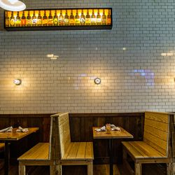 Seating across from the bar is a little darker and cozier than at the front of the space.