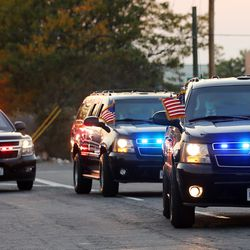 Vice President Mike Pence's motorcade moves toward I-215 as he arrives in Salt Lake City on Monday, Oct. 5, 2020.