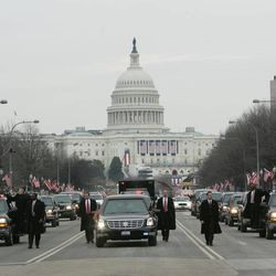 FILE - In this Thursday, Jan. 20, 2005 file photo, President George W. Bush's motorcade, heavily protected by U.S. Secret Service agents, moves up Pennsylvania Avenue from the U.S. Capitol, in background, towards the White House in Washington. The Secret Service has been tarnished by a prostitution scandal that erupted April 13, 2012 in Colombia involving 12 Secret Service agents, officers and supervisors and 12 more enlisted military personnel ahead of President Barack Obama's visit there for the Summit of the Americas.
