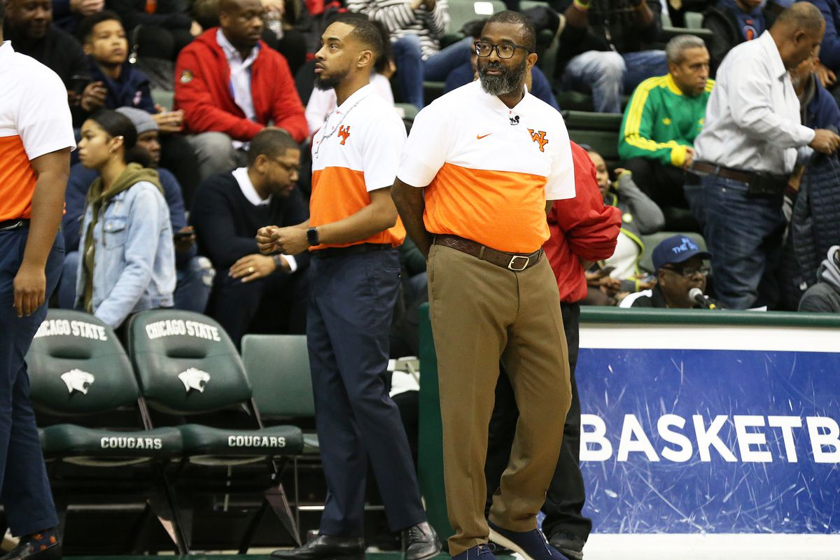 Young's coach Tyrone Slaughter as the Dolphins play Morgan Park at Chicago State.