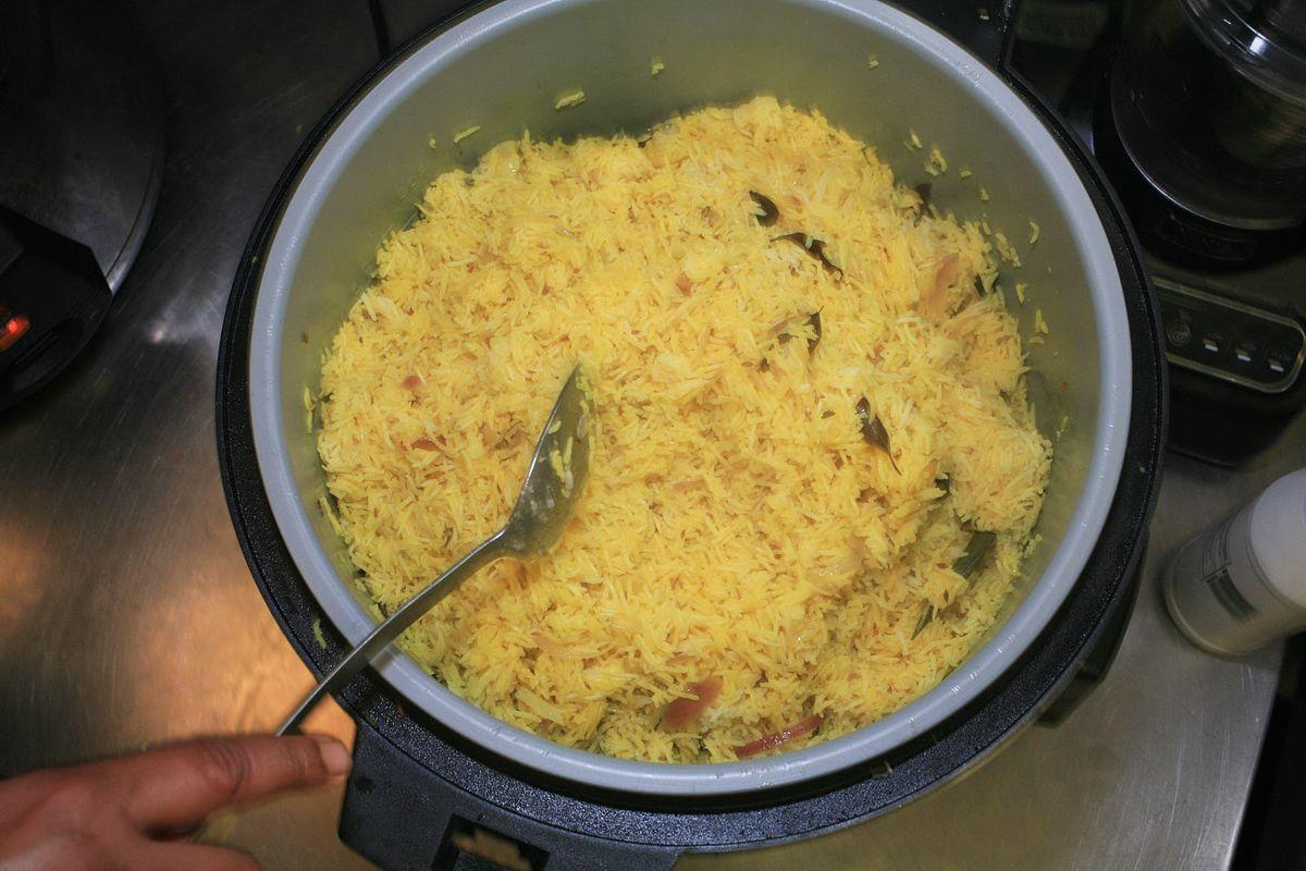 A pot of yellow-hued rice.