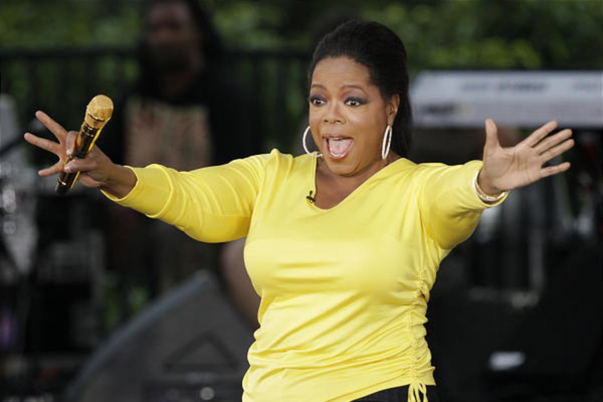 """Oprah Winfrey waves to her fans in Chicago while taping an episode of """"The Oprah Winfrey Show"""" last season."""
