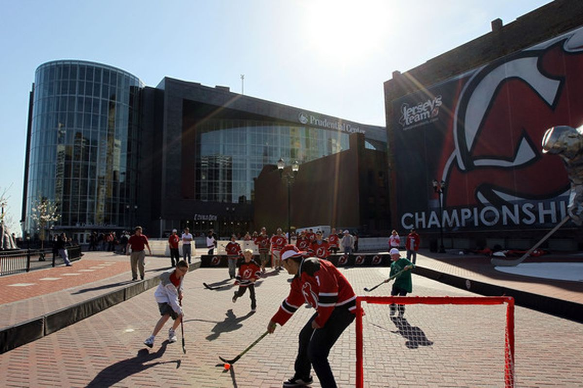 NEWARK, NJ - APRIL 02:  Fans play hockey prior to the Chicago Blackhawks playing the New Jersey Devils at the Prudential Center on April 2, 2010 in Newark, New Jersey.  (Photo by Jim McIsaac/Getty Images)