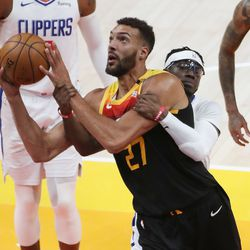Utah Jazz center Rudy Gobert (27) Is fouled by LA Clippers guard Reggie Jackson (1) during the NBA playoffs in Salt Lake City on Thursday, June 10, 2021. The Jazz won 117-111.