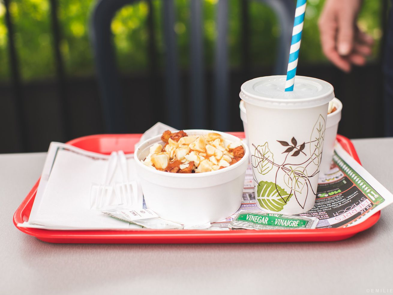tray with poutine and drink