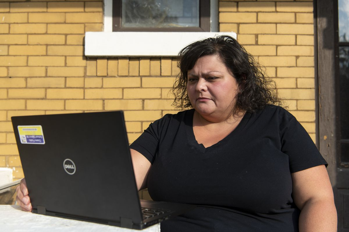Rachel Esposito, president of the Cicero Council of the West Suburban Teachers Union, listens in on a virtual meeting at her Brookfield home on Friday, Oct. 9, 2020.