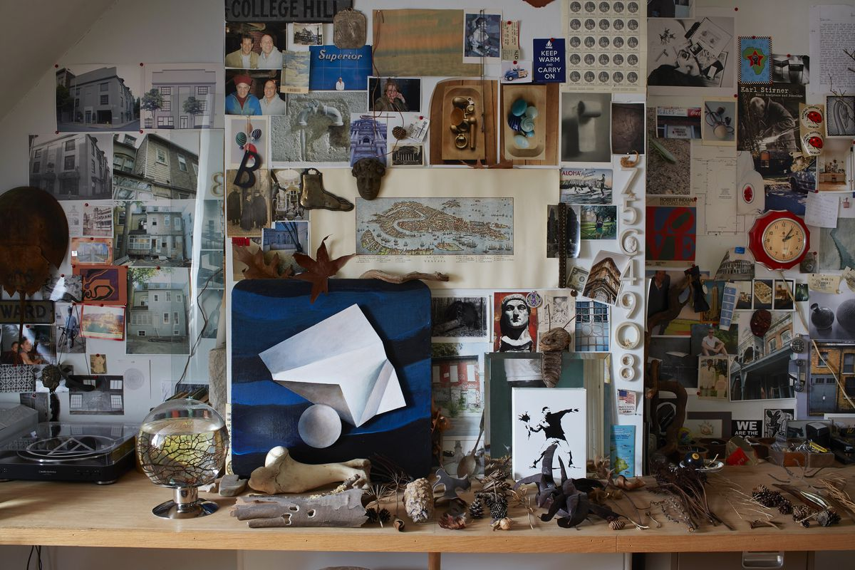 Martinez has dozens and dozens of images on the wall above his desk, making a colorful collage.