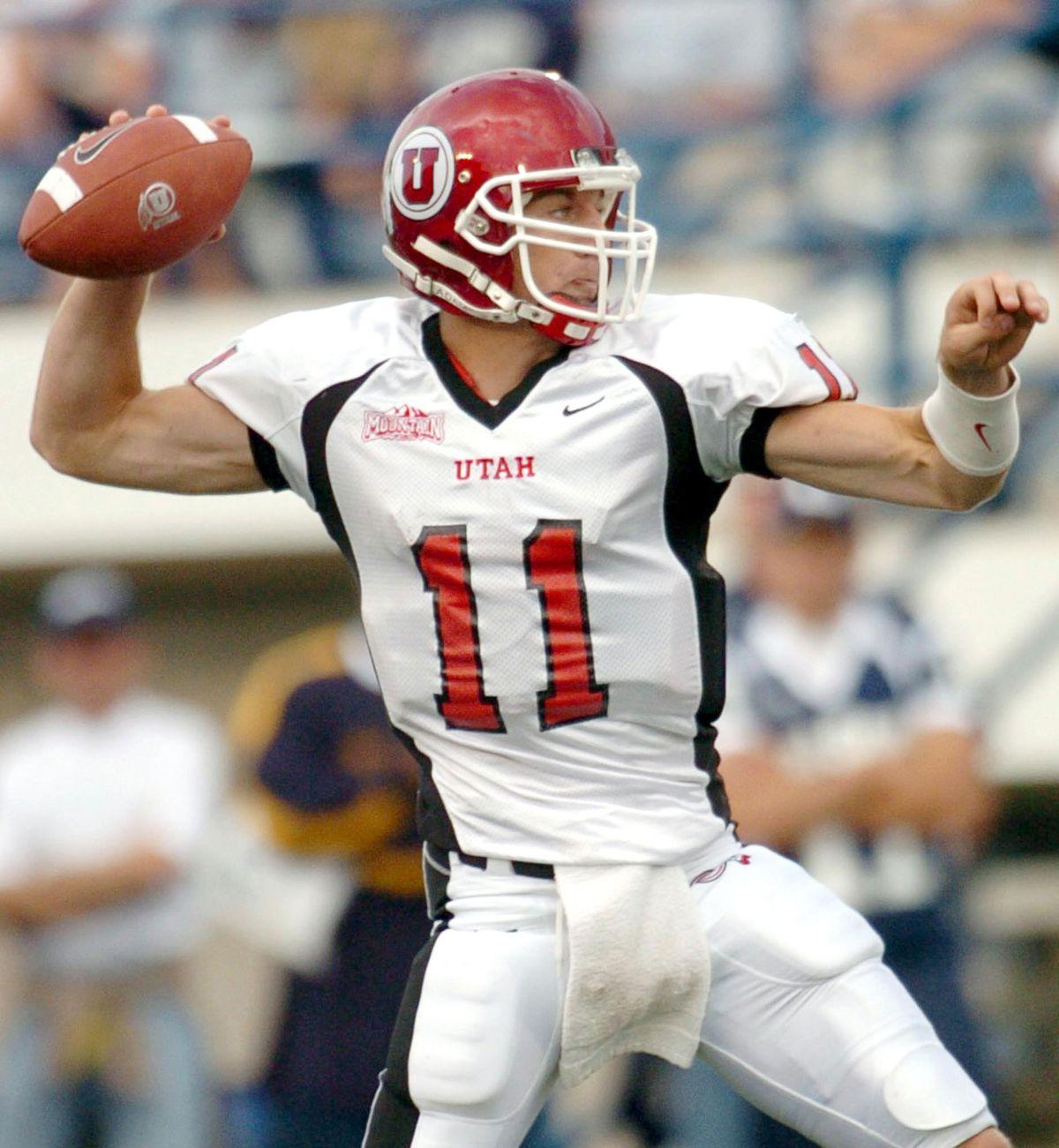 Utah quarterback Alex Smith sets to make a pass during game against Logan Saturday, Sept. 18, 2004.
