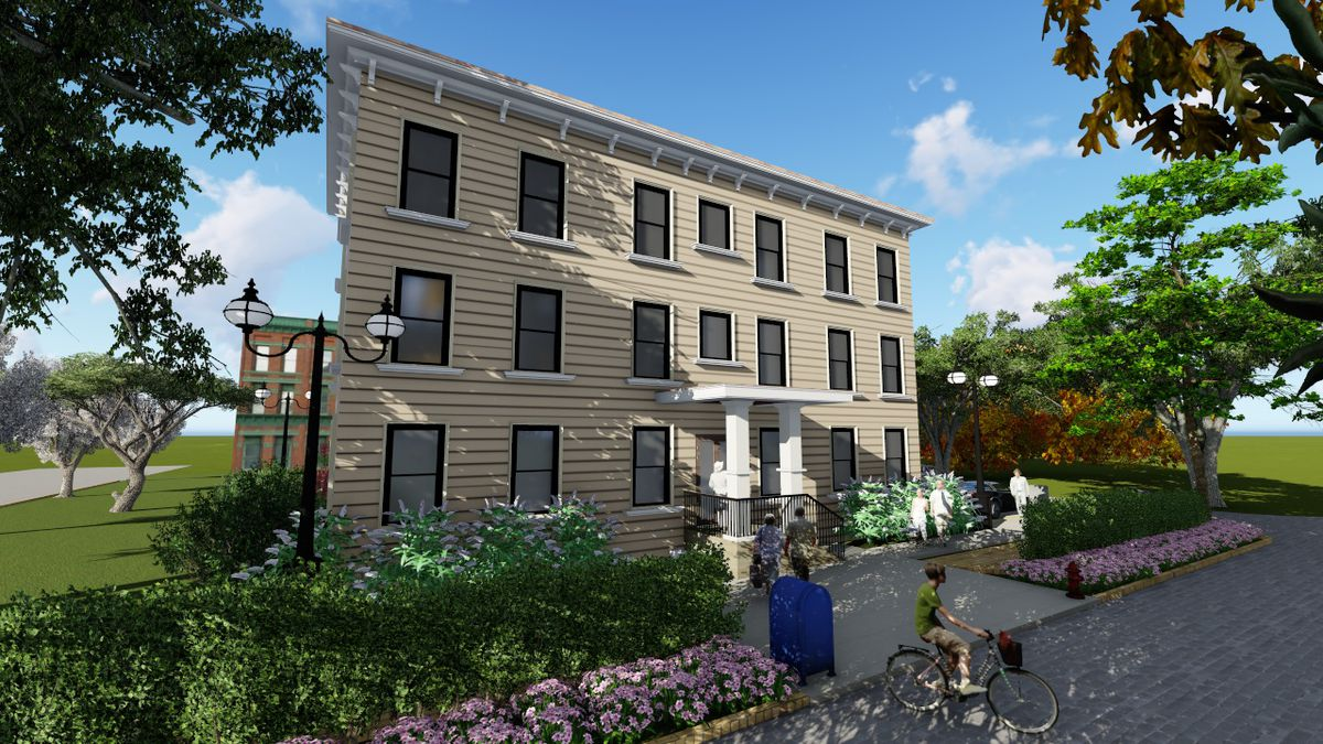 Rendering of a white-brick three-story apartment building with some landscaping out front.