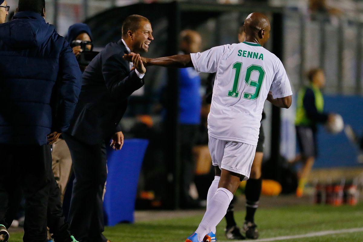 Coach Savarese interacts with Spanish midfielder Marcos Senna