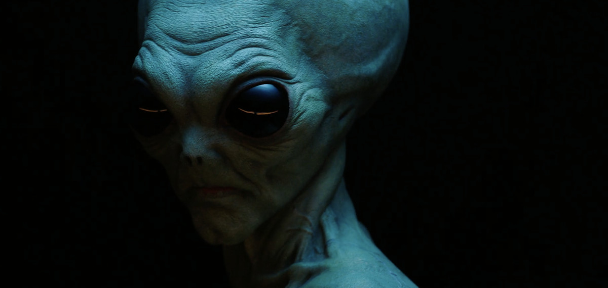 a creepy alien set against a black background