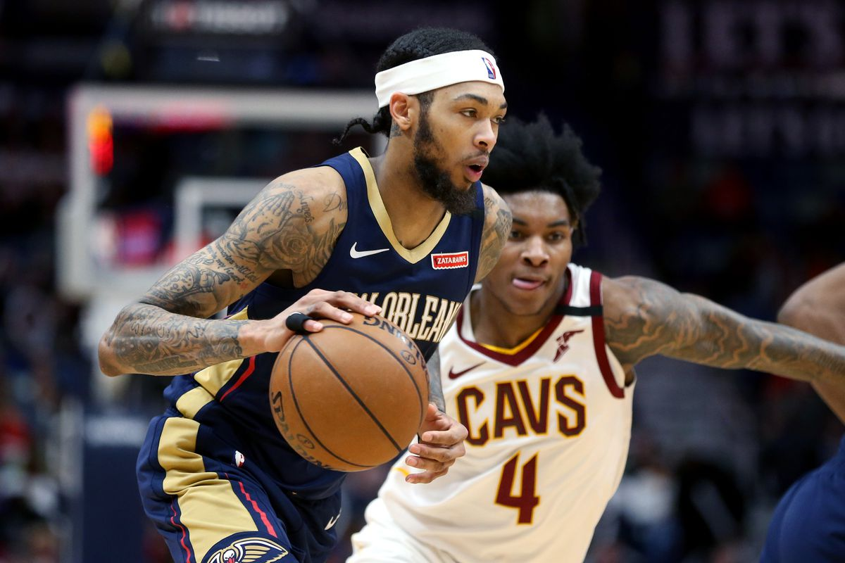 New Orleans Pelicans forward Brandon Ingram drives around Cleveland Cavaliers guard Kevin Porter Jr. in the second half at the Smoothie King Center.