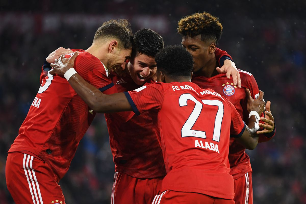 MUNICH, GERMANY - MARCH 17: James Rodriguez of Bayern Munich celebrates scoring his teams fourth goal with Leon Goretzka, David Alaba and Kingsley Coman during the Bundesliga match between FC Bayern Muenchen and 1. FSV Mainz 05 at Allianz Arena on March 17, 2019 in Munich, Germany.