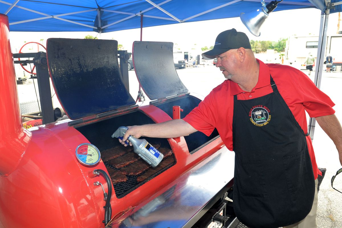 Curtis Trigueiro of Bakersfield, Calif., competes in Smokin in Mesquite BBQ Championship at the CasaBlanca last year.