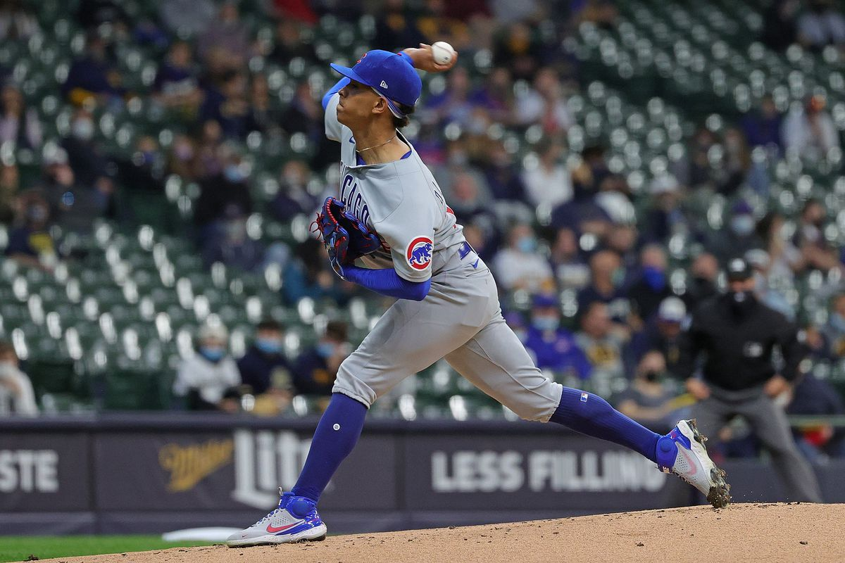Cubs starter Adbert Alzolay delivers a pitch during the first inning against the Brewers on Monday.