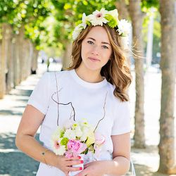 """Sofia Svensk wears soft curls and a flower crown at her City Hall <a href=""""http://sf.racked.com/archives/2014/06/12/sf-city-hall-wedding.php"""">wedding</a>; photo by <a href=""""http://www.kimlucian.com/"""">Kim Lucian Photography</a>"""