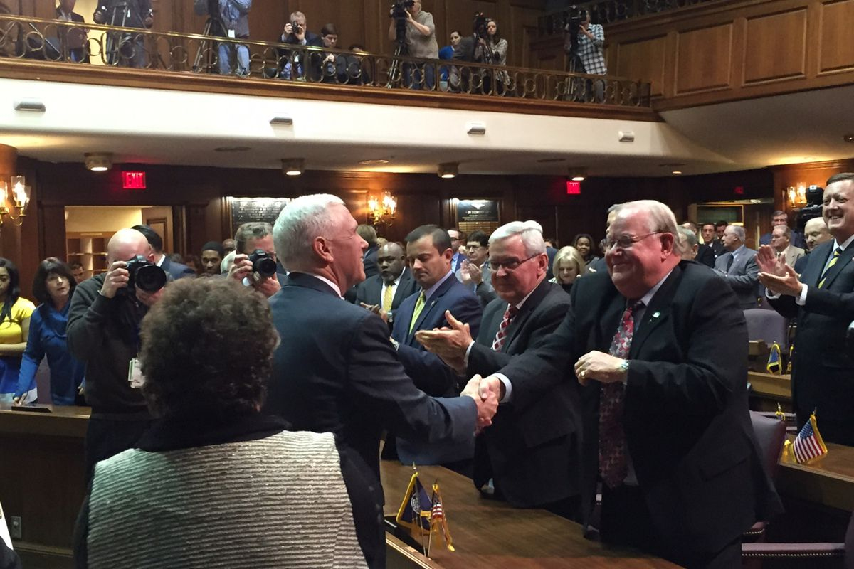Gov. Mike Pence greets Republican lawmakers after his State of the State address Tuesday night.