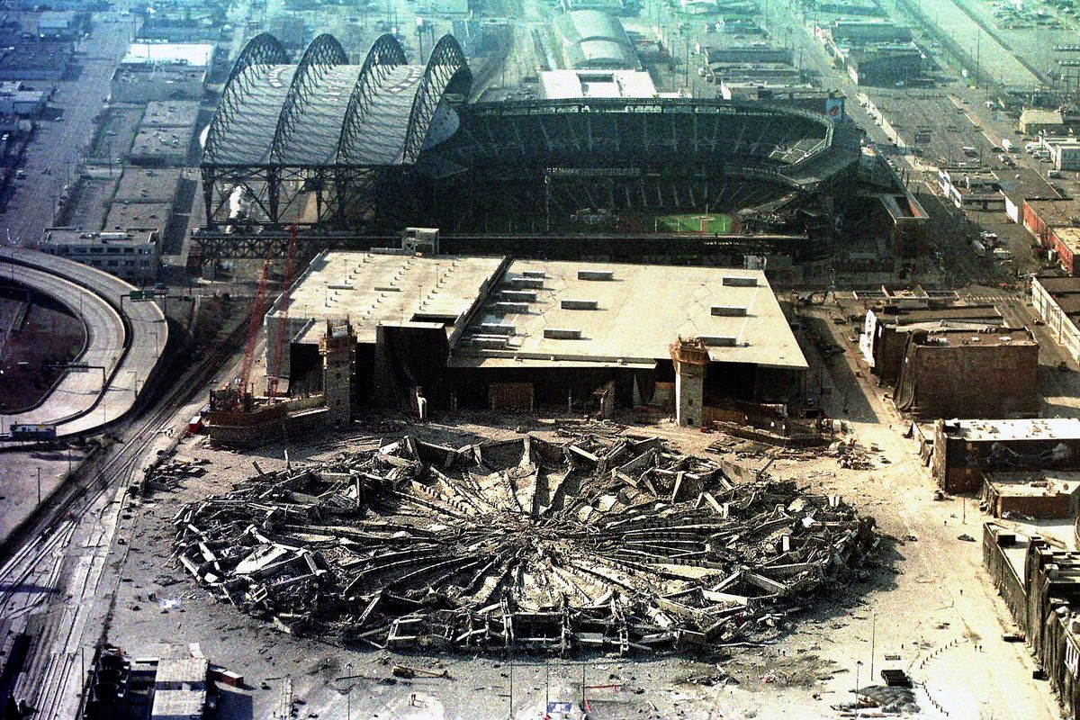 The Seattle Kingdome lies flattened by the force o