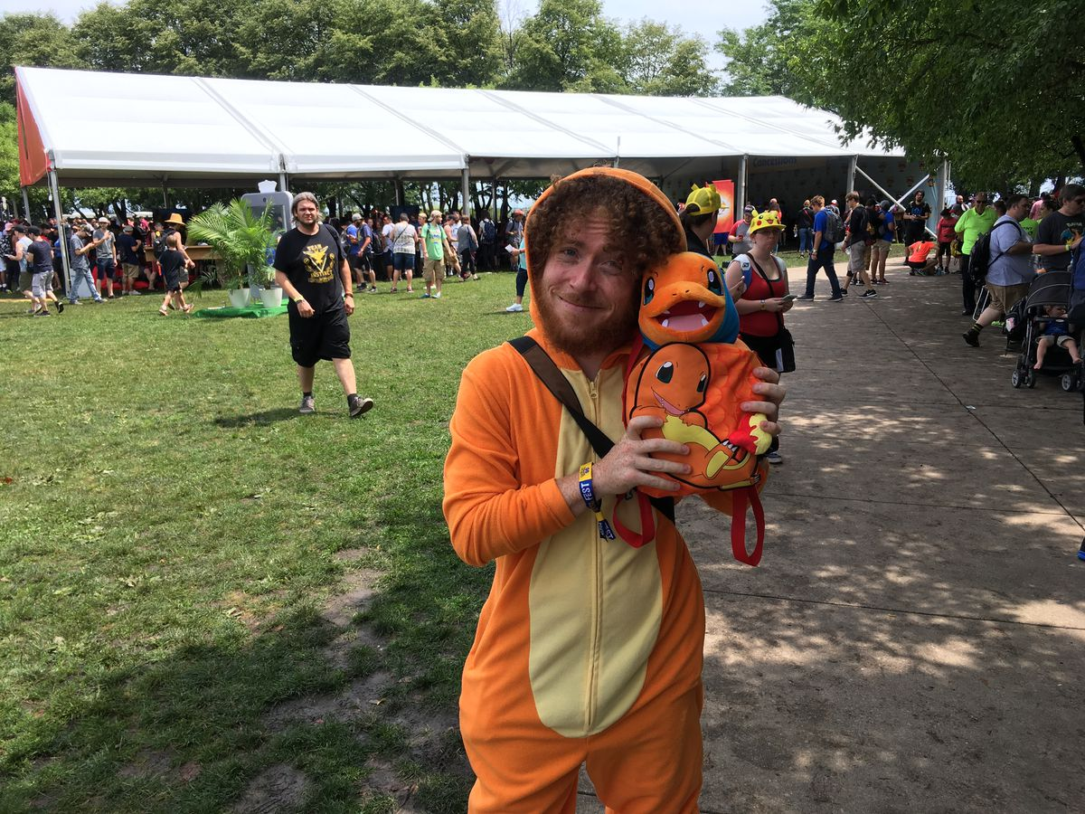 Most days, Joe Torres is a student at the University of Illinois at Chicago, studying computer science. On Saturday, he was Charmander Lives in Westchester, seen here holding War Turtle. Torres says he showed up without a ticket and that someone spotted h