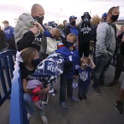 Brett Braegger and his children Hudson, Paityn, Boston and Kamden wait to enter LaVell Edwards Stadium in Provo on Saturday, Oct. 24, 2020.