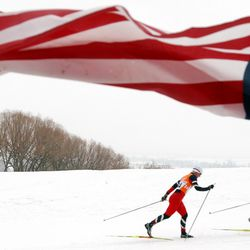 Marit Bjoergen, left, of Norway, and Katrin Smigun, of Estonia, race in the women's 30k cross-country race at Soldier Hollow on Sunday, Feb. 24, 2002.