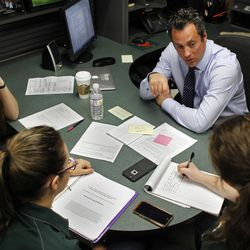 Michael Roe, principal of Poly High School, meets with students Renee Quillen, 15, left; McKenna Elton, 16; and Deborah Platt, 15, from the Poly Social Justice Council in Roe's office on Feb. 16, 2016, in the city of Riverside.