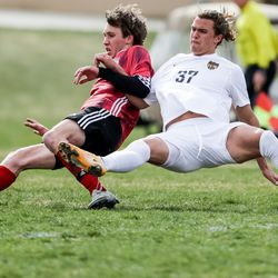 Springville's Tyson Peterson and Wasatch's Gabe Manning fall to the grass during a boys soccer game in Springville on Tuesday, March 23, 2021.