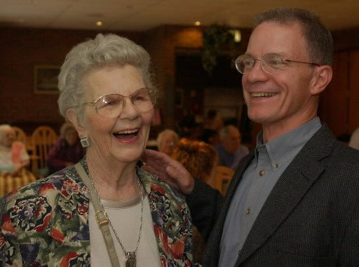 Illinois State Poet Laureate Kevin Stein shares a laugh with Grace Cley during a visit to the Norward Park Home for seniors in 2004. Sun-Times photo by Al Pogorski
