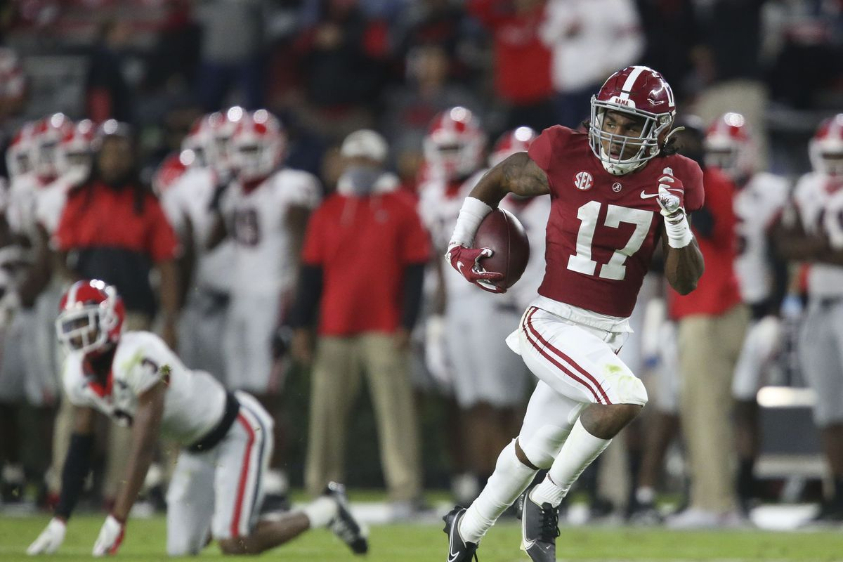 Alabama wide receiver Jaylen Waddle catches a pass after Georgia defensive back Tyson Campbell fell. Waddle turned the catch into a 90 yard touchdown during the second half of Alabama's 41-24 win over Georgia at Bryant-Denny Stadium