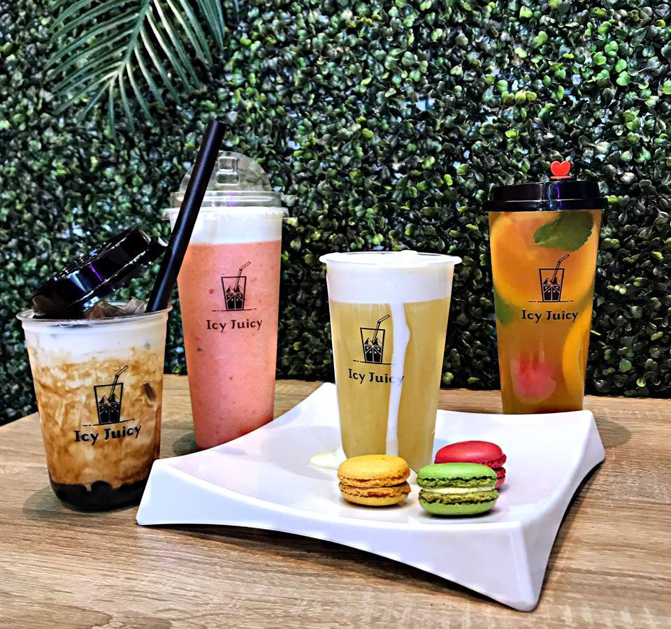 Selection of tea beverages in front of leafy background