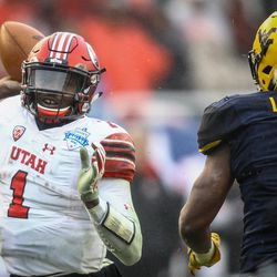 Utah Utes quarterback Tyler Huntley (1) throws for a first down during the Zaxby's Heart of Dallas Bowl between the Utah Utes and the West Virginia Mountaineers in Dallas Texas on Tuesday, Dec. 26, 2017.