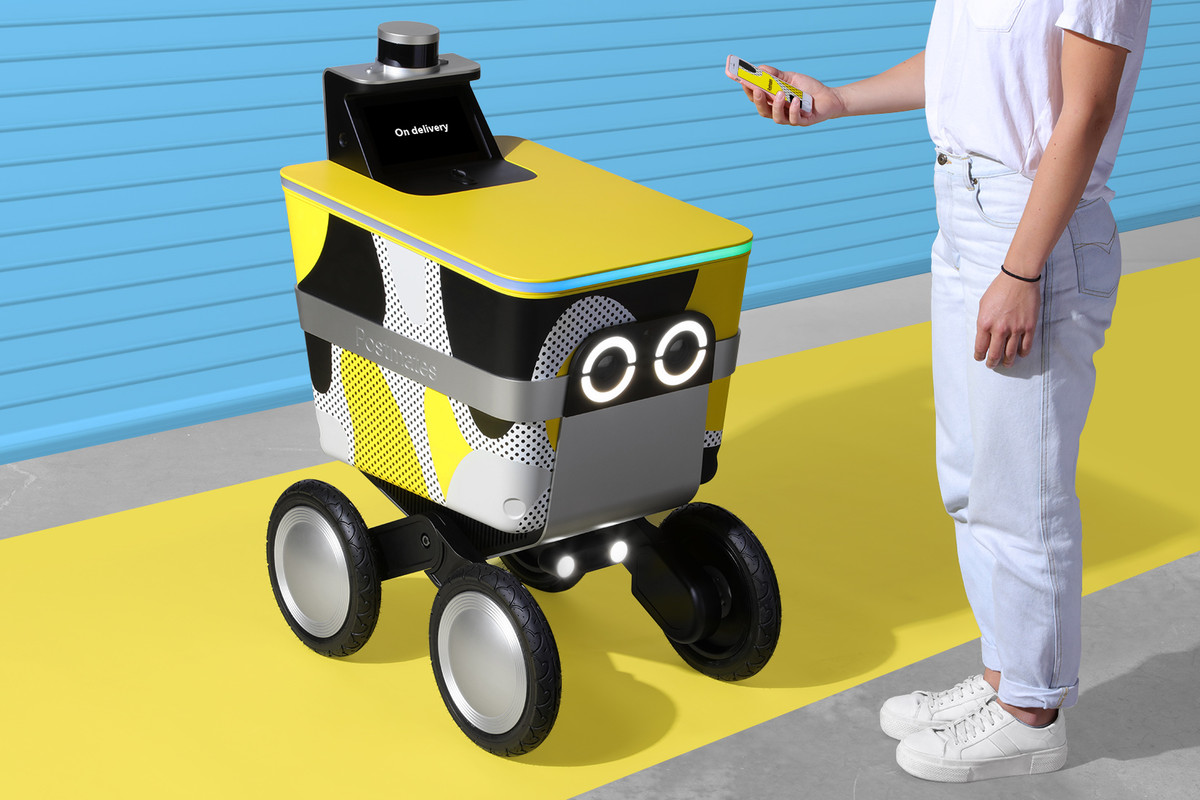 A four-wheeled delivery robot with large cartoon eyes.