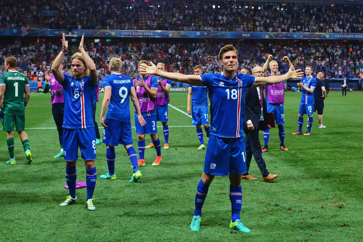 Elmar Bjarnason (R) and Iceland players celebrate after the UEFA EURO 2016 round of 16 match between England and Iceland at Allianz Riviera Stadium on June 27, 2016 in Nice, France.