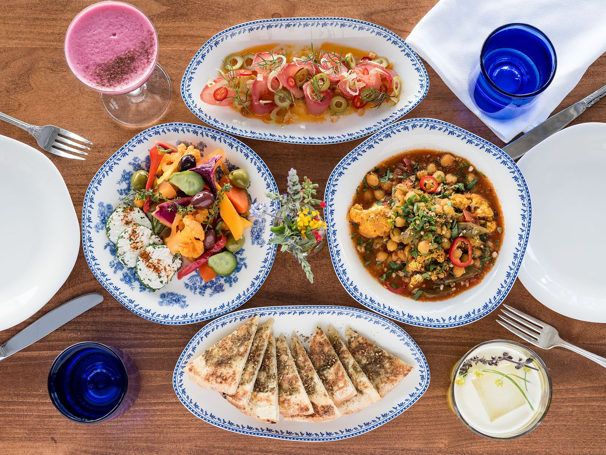 Array of dishes on white and blue plates at Jaffa restaurant