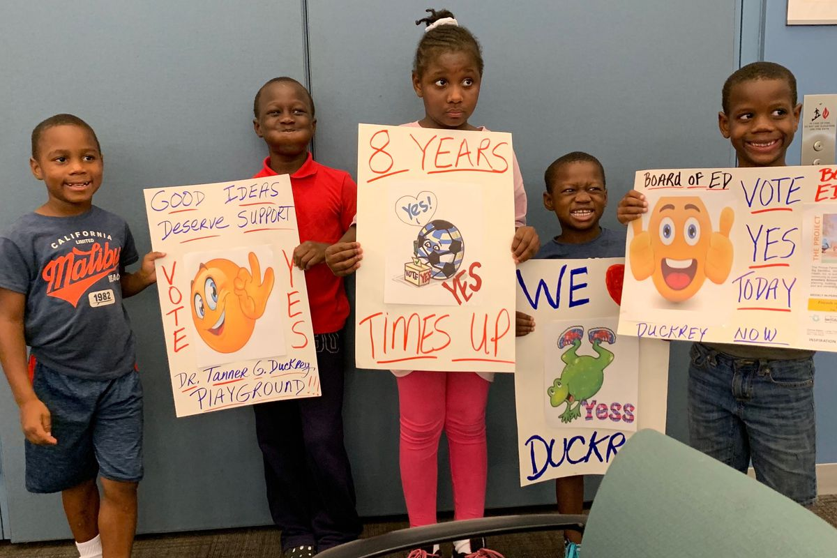 Duckrey students advocate for their playground at Thursday night's Board of Education meeting.