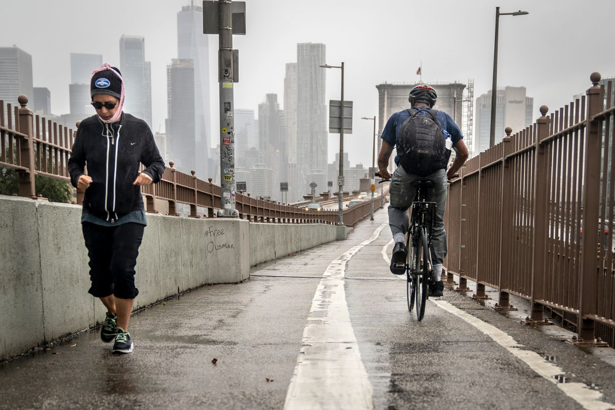 Cyclists and pedestrians share a narrow path leading to the Brooklyn Bridge on Friday.