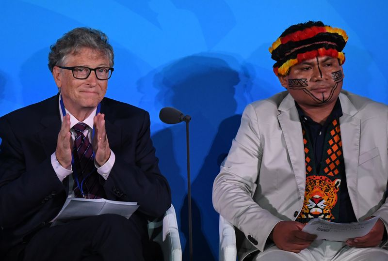 Bill Gates (L) and Indigenous Peoples Representative, Tuntiak Katan (R) attend the UN Climate Action Summit on September 23, 2019 at the United Nations Headquarters in New York City.