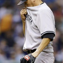New York Yankees starting pitcher Freddy Garcia reacts during the fifth inning of a baseball game against the Tampa Bay Rays, Tuesday, Sept. 4, 2012, in St. Petersburg, Fla.