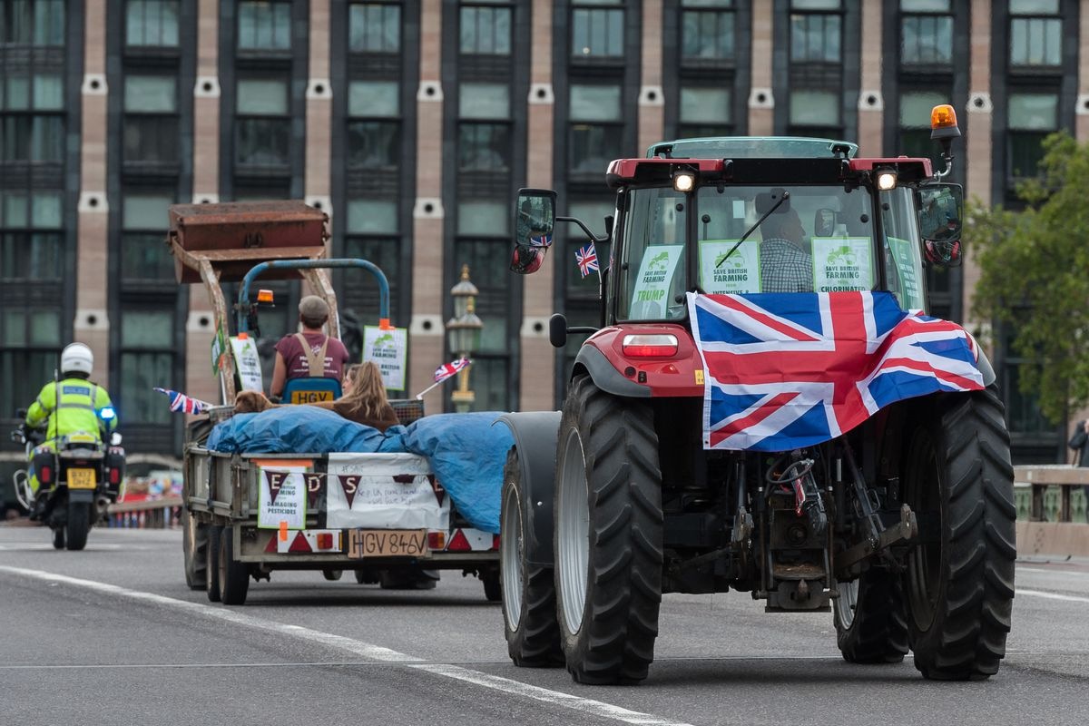 A farming tractor draped in a British flag in a protest outside the House of Commons