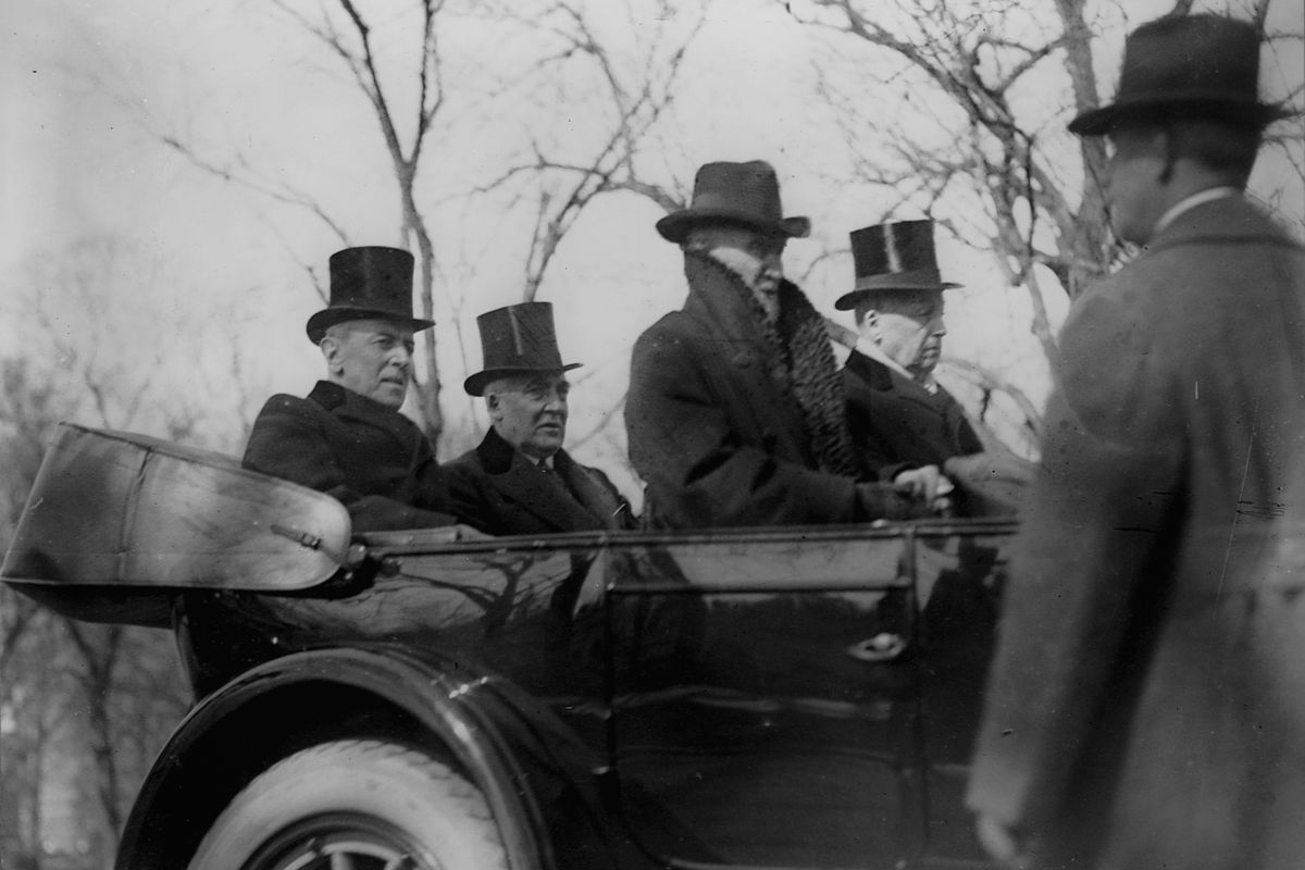 """Woodrow Wilson rides in the Presidential motorcade with Warren Harding on the way to the latter's inauguration. In front are two of Wilson's strongest opponents, Speaker of the House Joseph """"Uncle Joe"""" Cannon and Senator Philander Knox."""