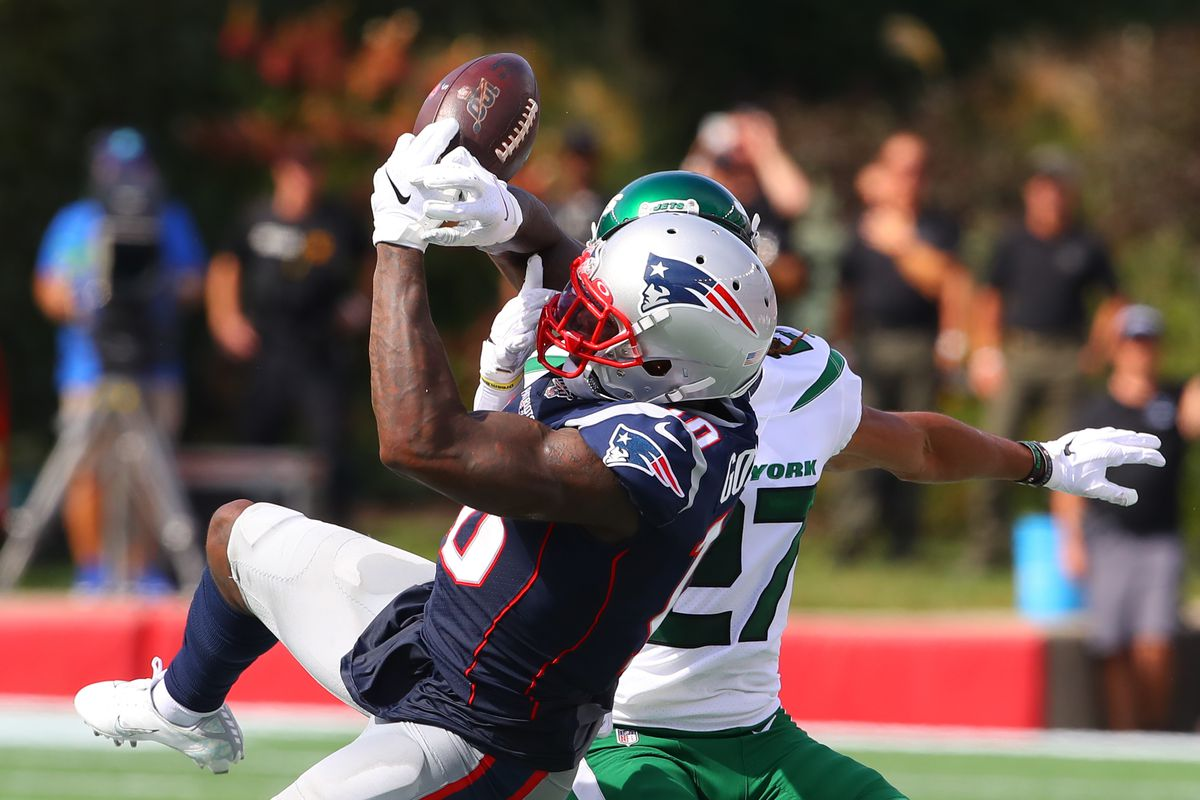 New England Patriots wide receiver Josh Gordon has the ball knocked away by New York Jets cornerback Darryl Roberts during the second quarter of the National Football League game on September 22, 2019 at Gilette Stadium in Foxborough, MA.