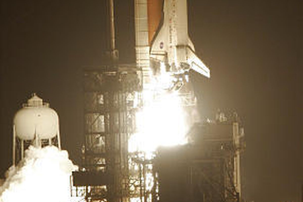 Space shuttle Discovery lifts off Friday from the Kennedy Space Center at Cape Canaveral, Fla.