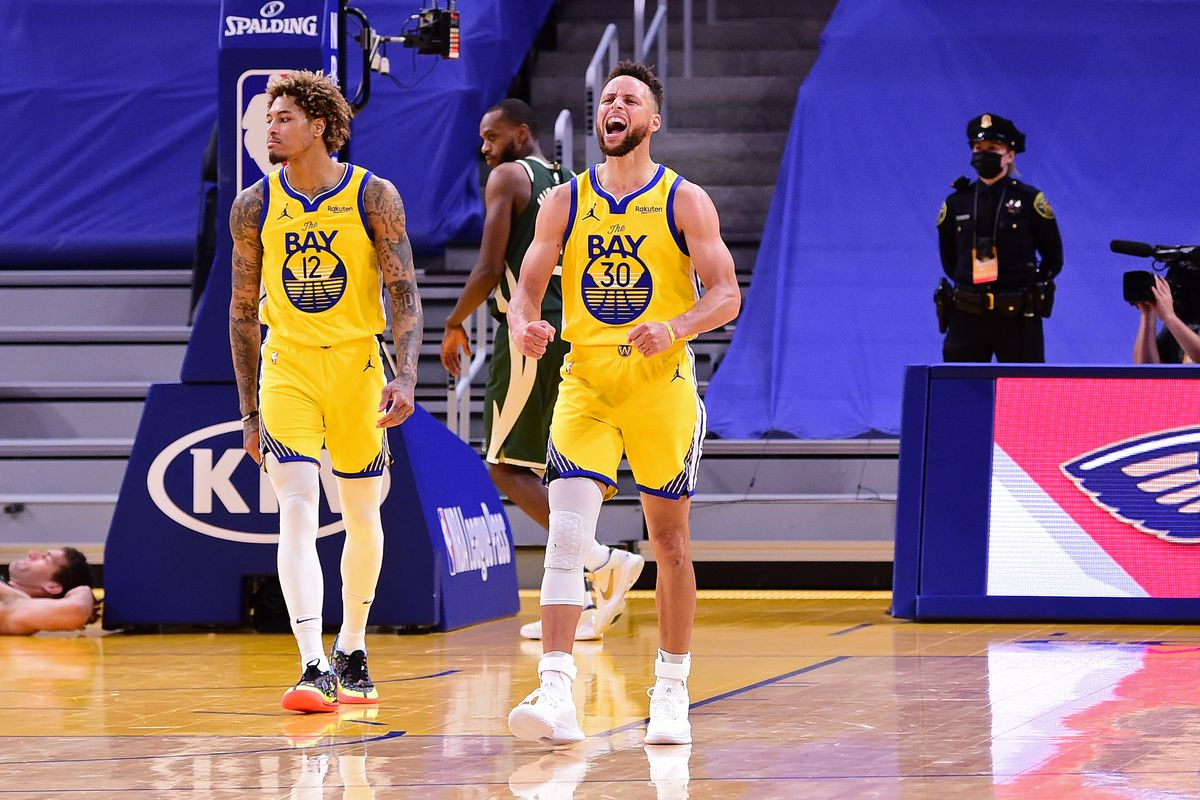 Stephen Curry #30 of the Golden State Warriors yells and celebrates on the court after the game against the Milwaukee Bucks on April 6, 2021 at Chase Center in San Francisco, California.