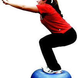 Amber Wride performs squats on a Bosu at the Sports Mall. These exercises help strengthen her quads and glutes, while improving stability in her legs and ankles.