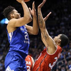 Brigham Young Cougars forward Yoeli Childs (23) shoots over Utah Utes guard Gabe Bealer (30) at the Marriott Center in Provo on Saturday, Dec. 16, 2017.