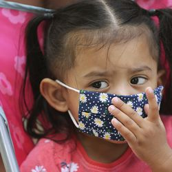 America Rodriguez adjusts her mask while shopping with her family at City Creek Center in Salt Lake City on Wednesday, May 6, 2020. The shopping center reopened Wednesday.