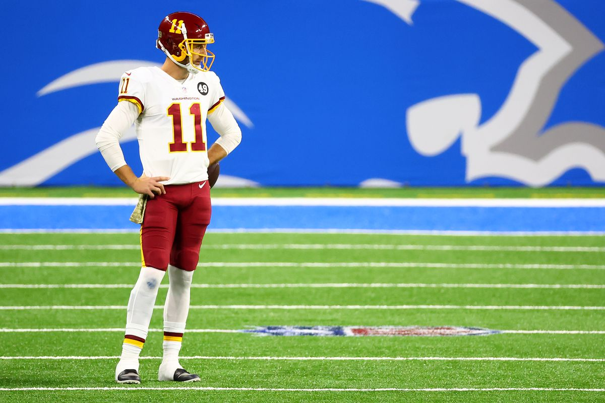 Alex Smith #11 of the Washington Football Team looks on during their game against the Detroit Lions at Ford Field on November 15, 2020 in Detroit, Michigan.